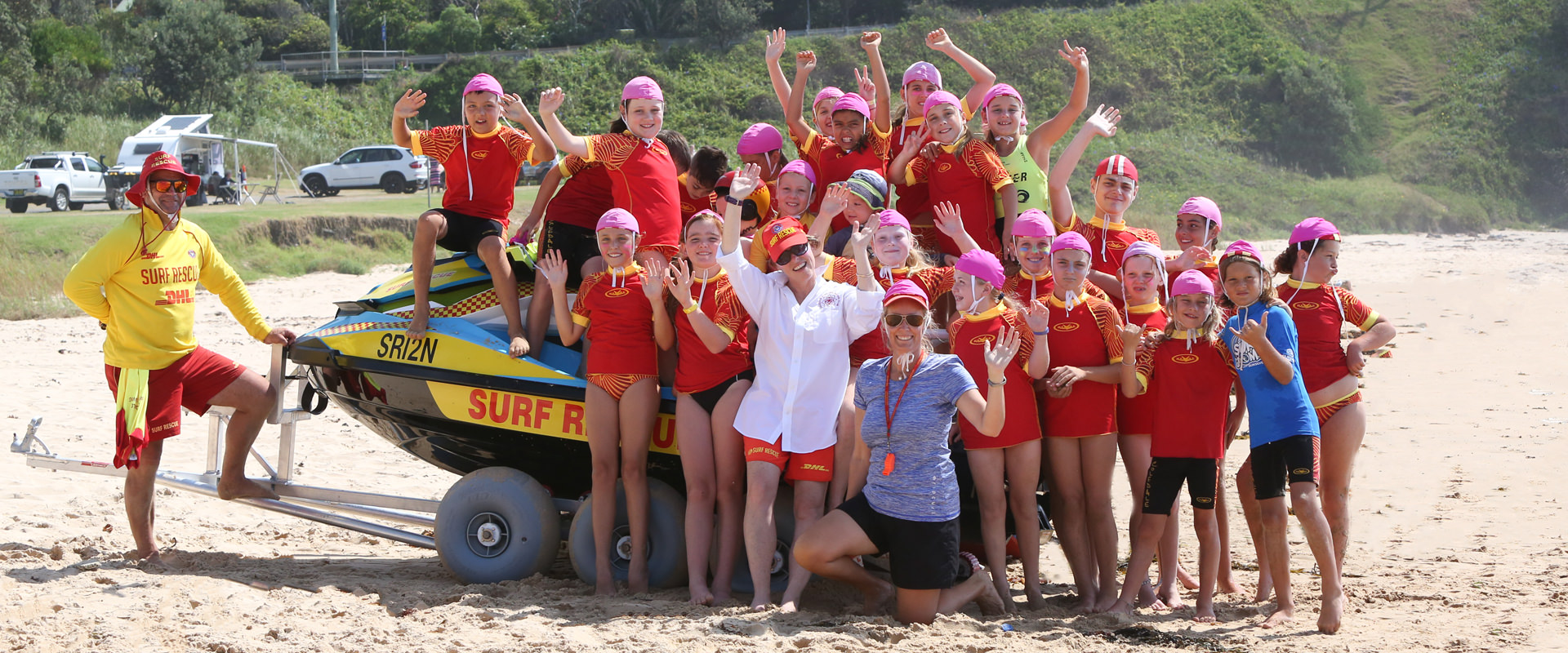 Nippers on surf craft on beach